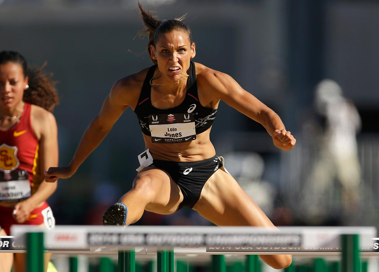 Lolo Jones takes flight while competing in the women's 100M hurdles during Day 3 of the USATF Outdoor Championships at Hornet Stadium in Sacramento, Calif.