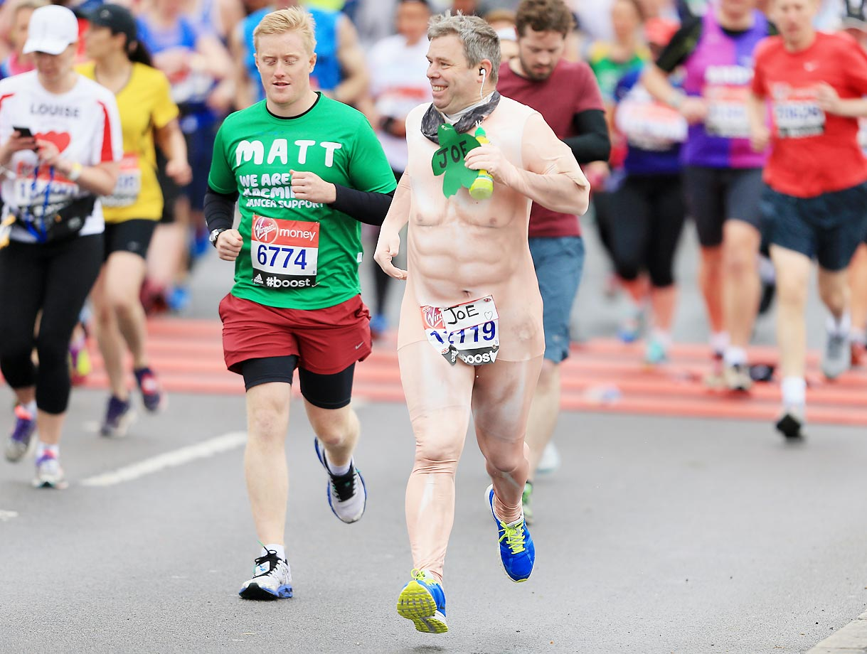 A runner dressed in a naked suit at the Virgin Money London Marathon.
