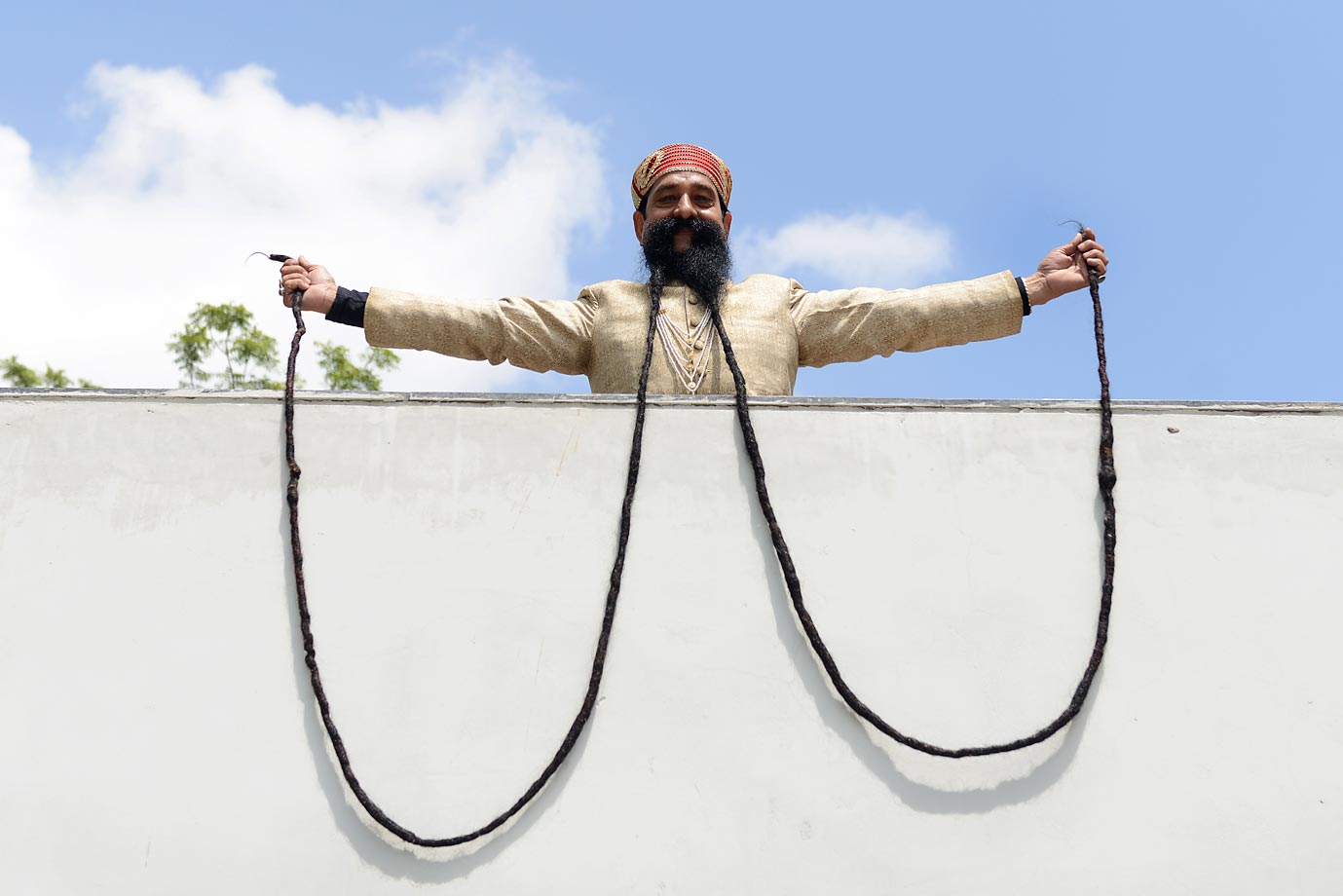 Ram Singh Chauhan (61) displays his approximately 18-foot-long moustache, which has been recognized by the Guinness Book of World Records.