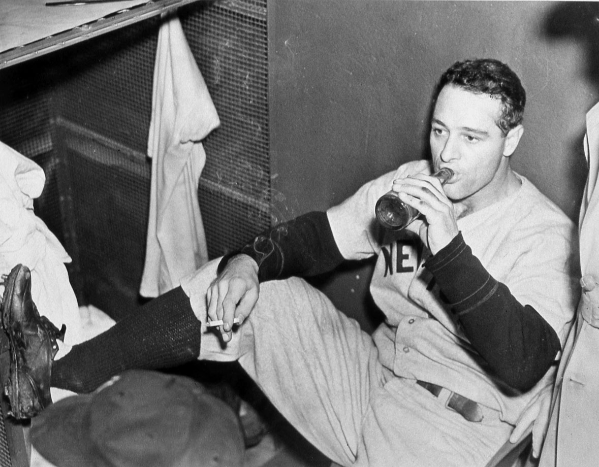 Lou Gehrig enjoys a beer and a cigarette after a game in Detroit in 1936.