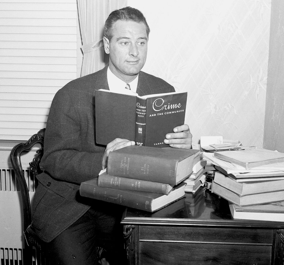 Upon retiring from baseball, Lou Gehrig accepted the post of City Parole Commissioner. Here, in Oct. 1939, he studies books on crime to prepare for the job.