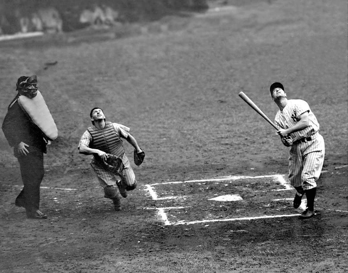 Lou Gehrig hits a foul ball as he plays despite a fractured thumb, extending his streak to 2,045 consecutive games on July 19, 1938.