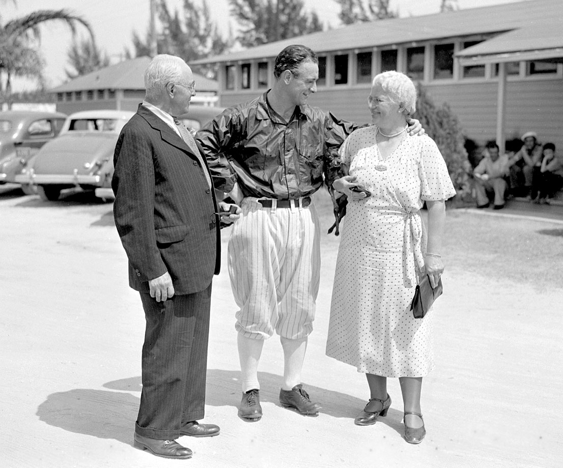 Lou Gehrig stands outside Higgins Field in St. Petersburg, Fla., with his mother and father in March 1938.