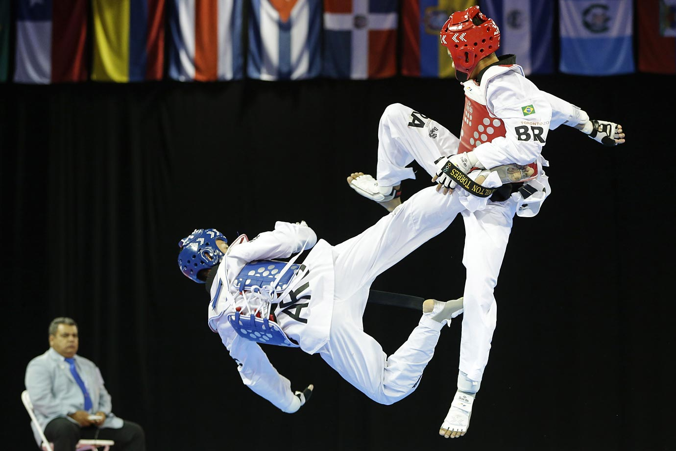 Argentina's Lucas Guzma fights Brazil's Venilton Torres during a 58kg bronze medal taekwondo match at the Pan Am Games. Guzman won.