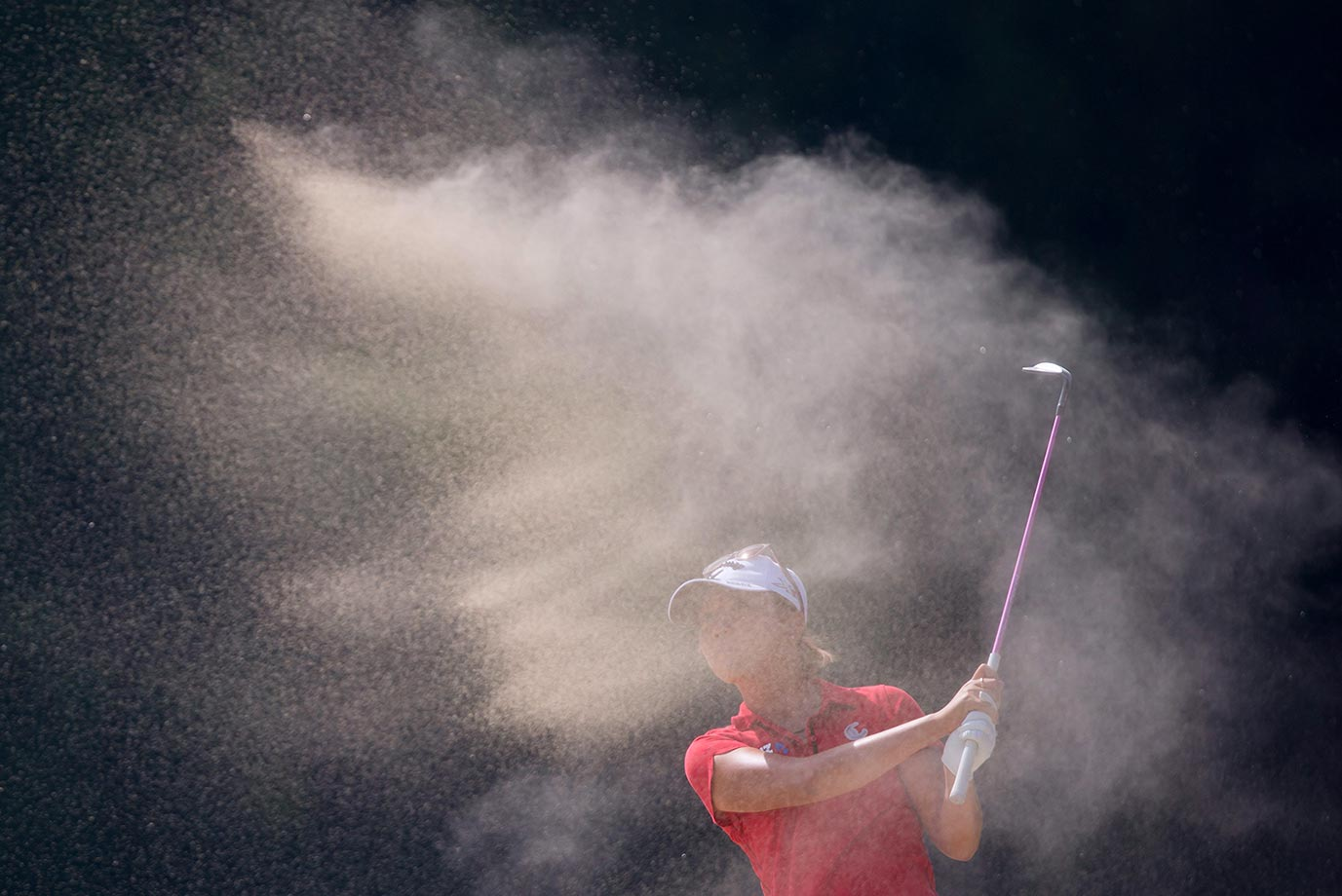 Lydia Ko hits out of a bunker on the fourth hole during the final round of the Canadian Pacific Women's Open golf tournament at Vancouver Golf Club.
