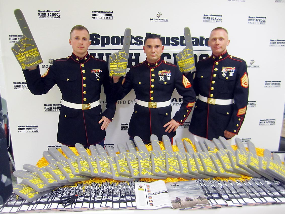 (From left) Sgt. Samuel Nasso, Sgt. Tyler Ledbetter and Staff Sgt. Eric Sowers held their foam fingers high as they proudly represented the U.S. Marine Corps in helping to recognize Maddy.