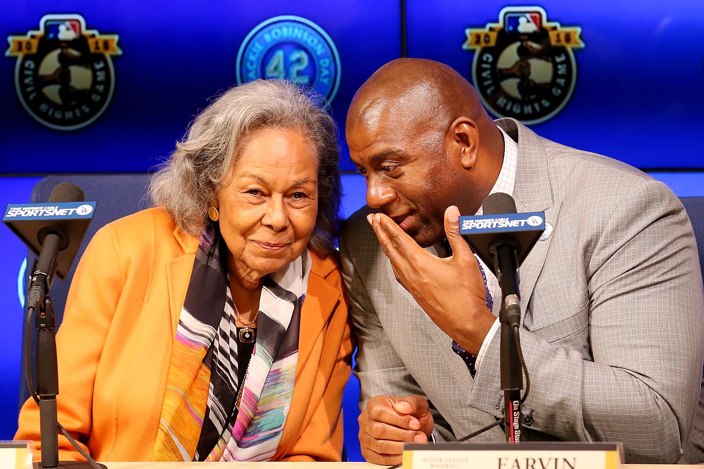 Rachel Robinson, the widow of Jackie Robinson, and Magic Johnson share a little chuckle at a press conference before the Jackie Robinson Day festivities in Los Angeles.