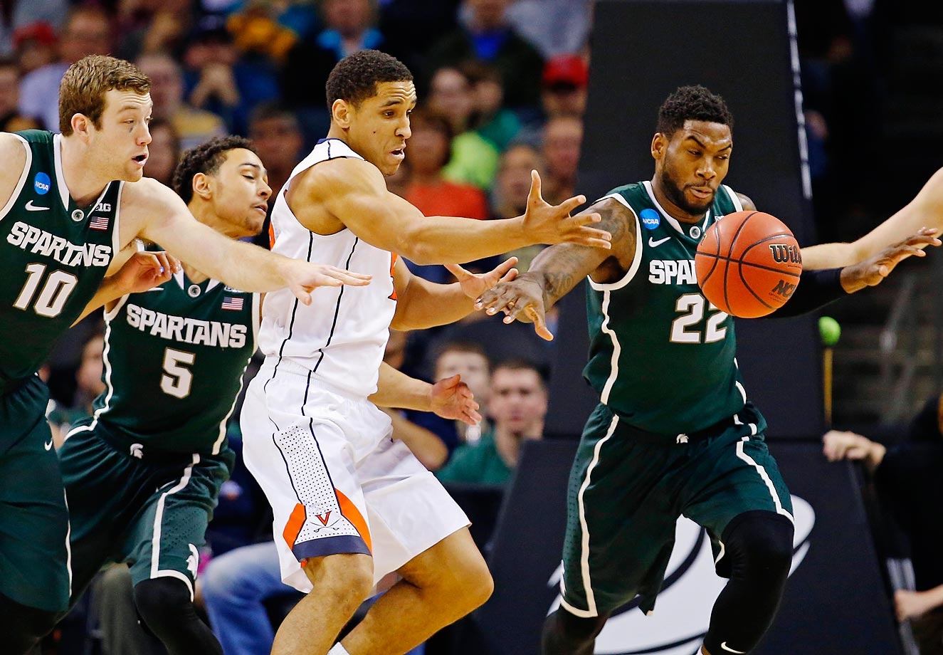 Malcolm Brogdon of Virginia is surrounded by Matt Costello, Bryn Forbes and Branden Dawson of Michigan State.