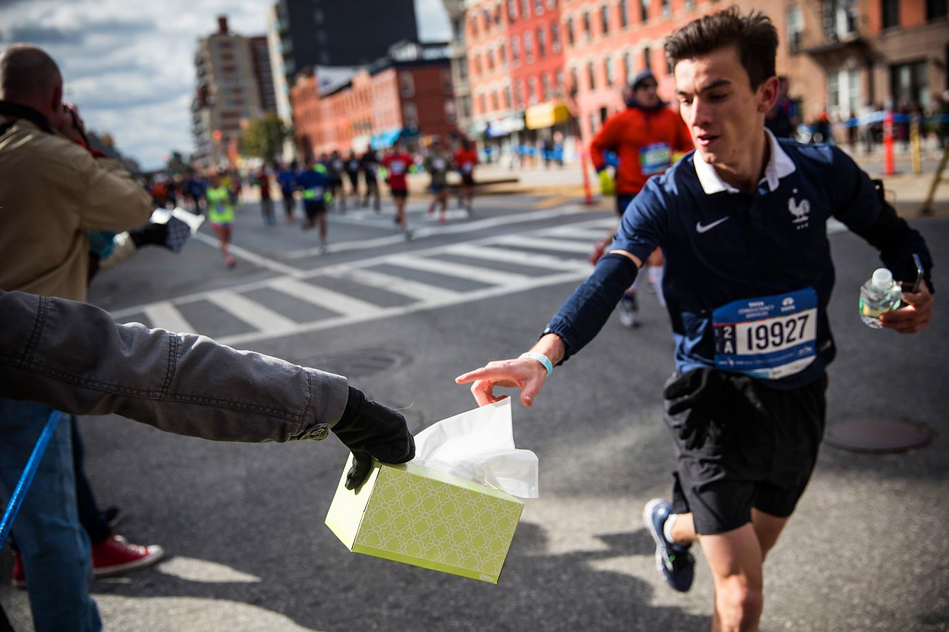 One would think there would be a higher-tech way of handing out tissues at the NYC Marathon.