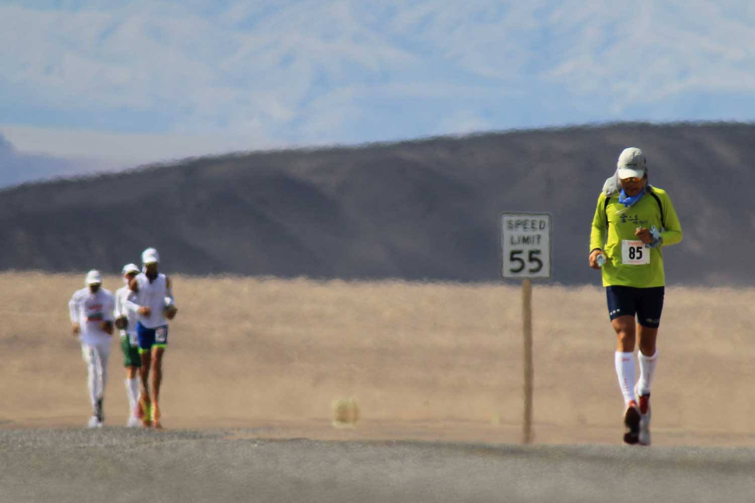 Runners trekking through the AdventurCORPS Badwater 135 ultra-marathon race in Death Valley National Park, California, where average temperatures can reach 116 degrees.