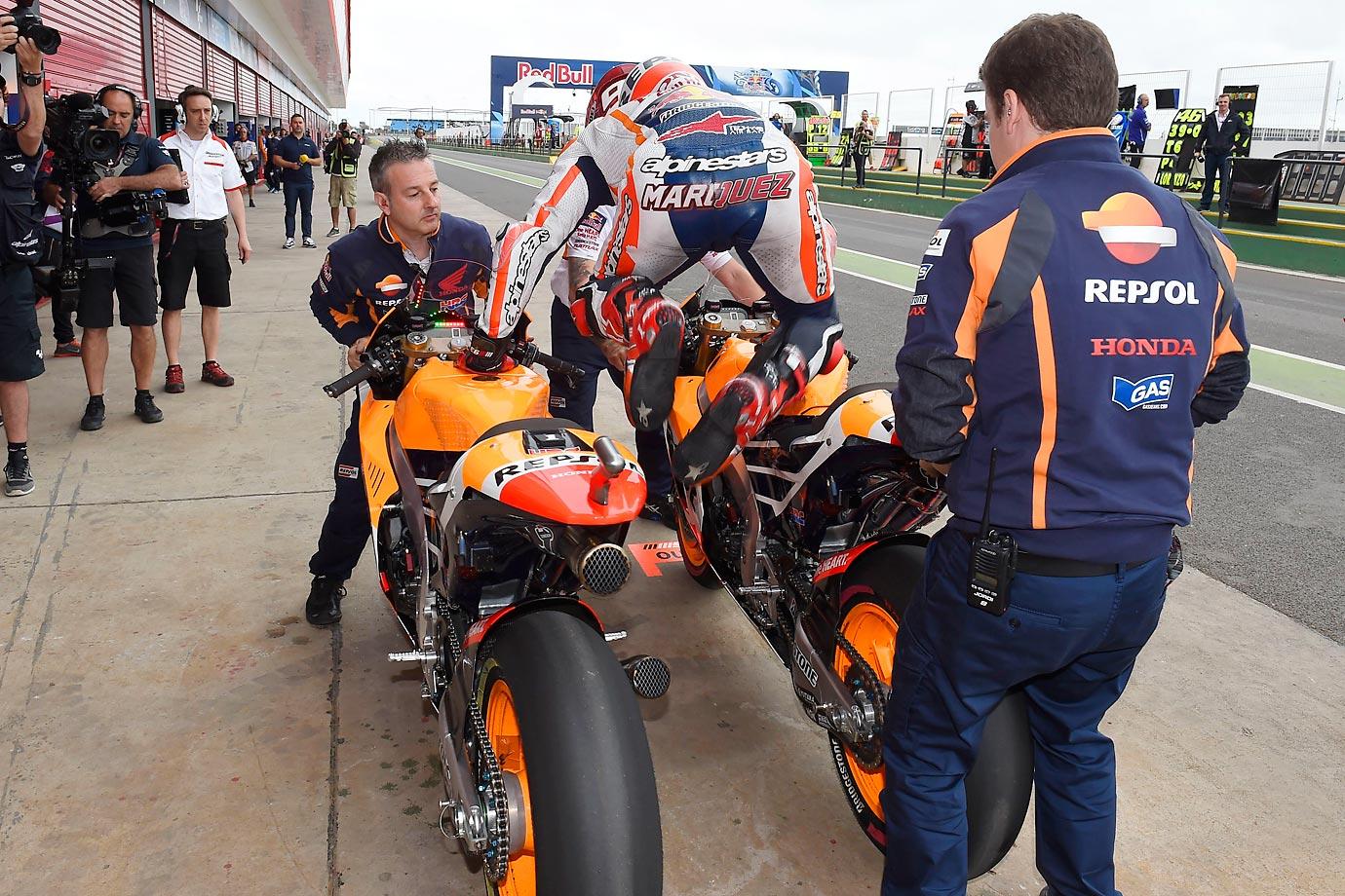 Marc Marquez leaps onto a new bike during the Moto GP in Termas de Rio Honda, Argentina.