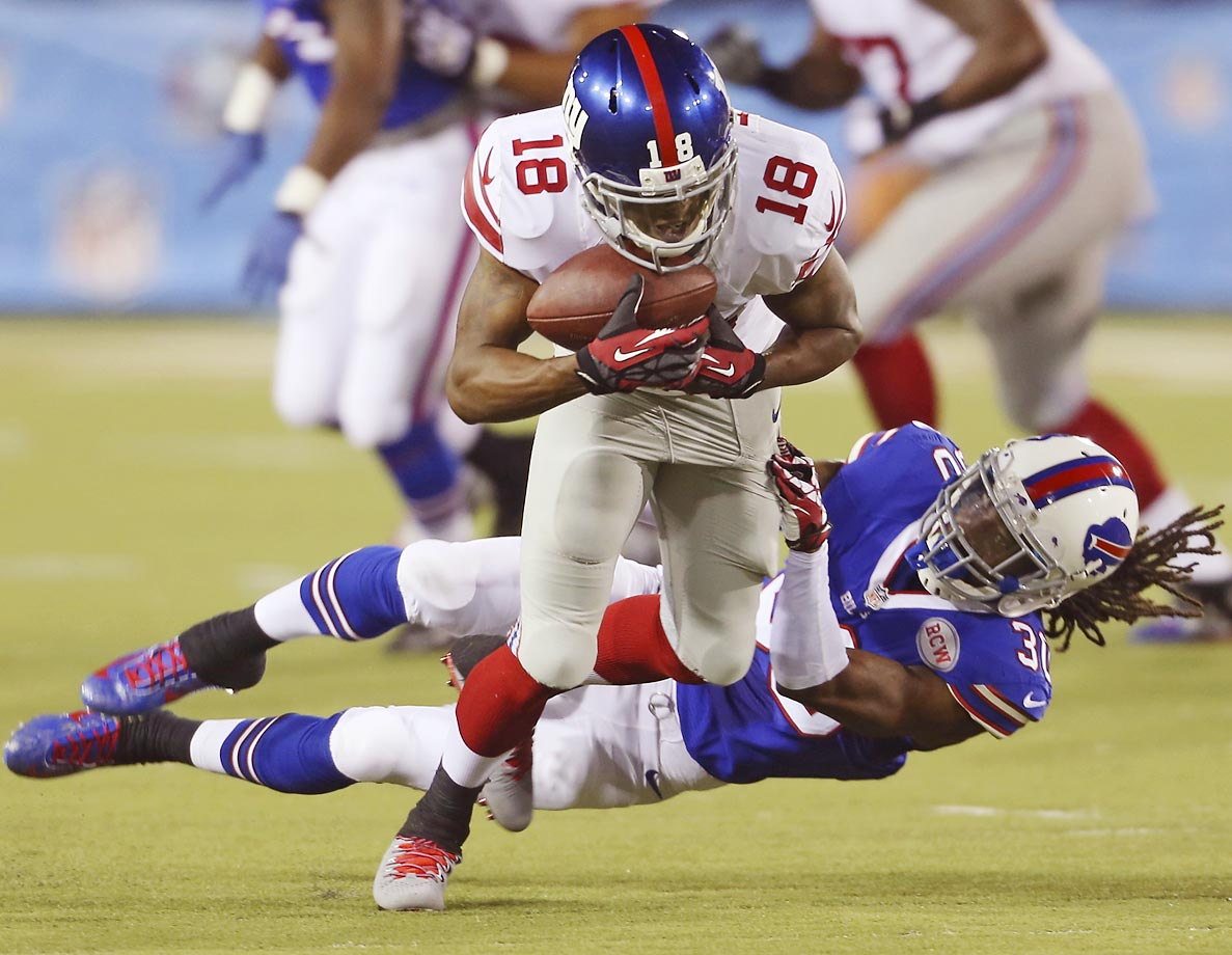 New York Giants wide receiver Marcus Harris tries to break away from Buffalo Bills defensive back Mario Butler after Harris caught a pass in the second quarter at the Pro Football Hall of Fame exhibition NFL football game on Sunday, Aug. 3, 2014, in Canton, Ohio.