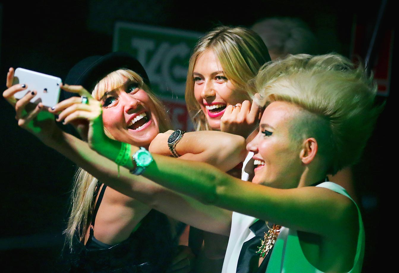 Maria Sharapova poses for a selfie with Miriam Nervo and Olivia Nervo before the Australian Open.