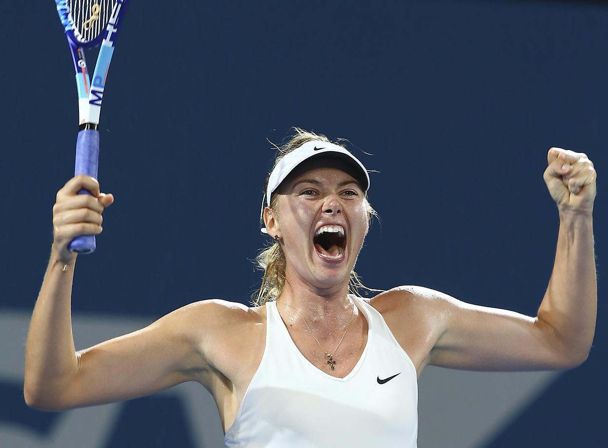 Maria Sharapova celebrates after she won the final match against Ana Ivanovic of Serbia 6-7, 6-3, 6-3 during the Brisbane International.