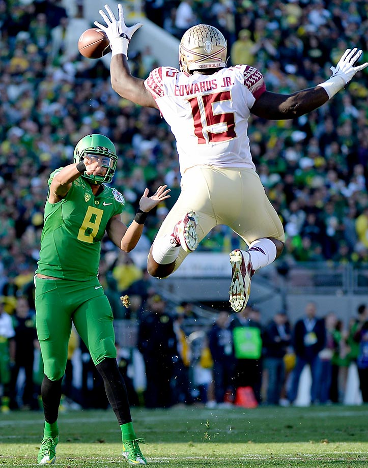 Defensive end Mario Edwards Jr. of the Florida State Seminoles attempts to block a pass by quarterback Marcus Mariota of the Oregon Ducks.