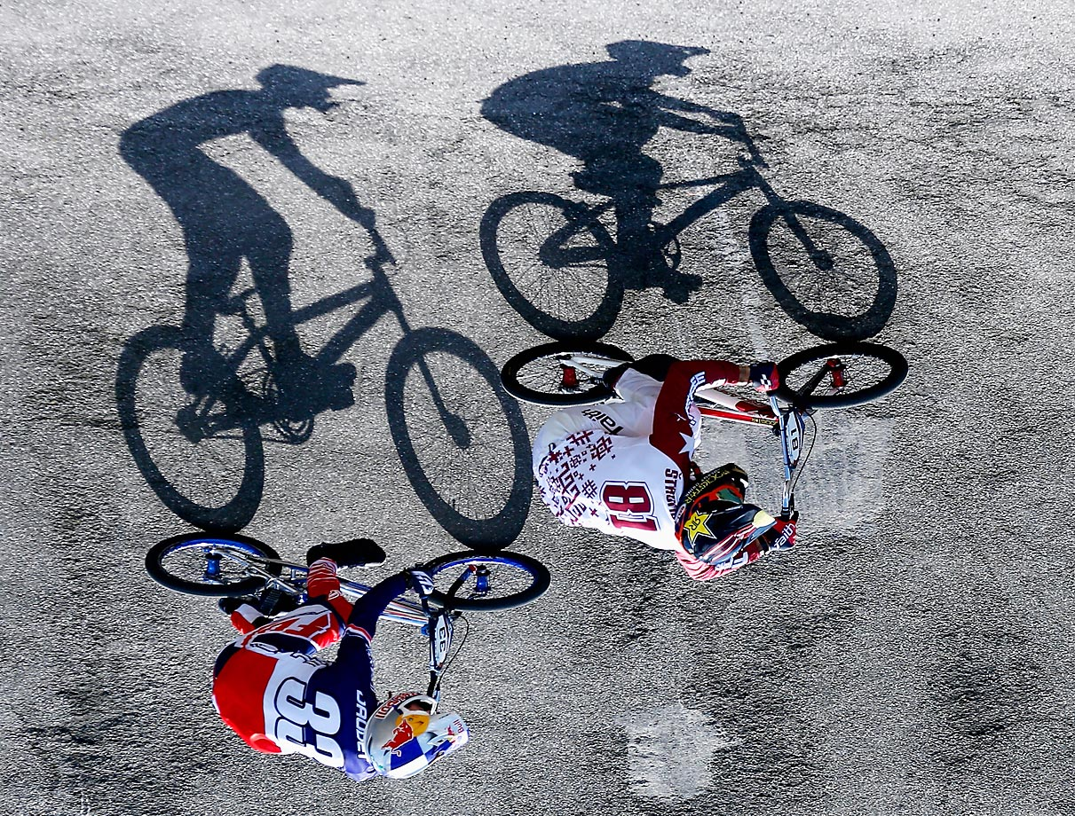 Maris Strombergs and Joris Daudet compete in the Mens Elite UCI BMX Supercross World Cup in Arnhem, Netherlands.