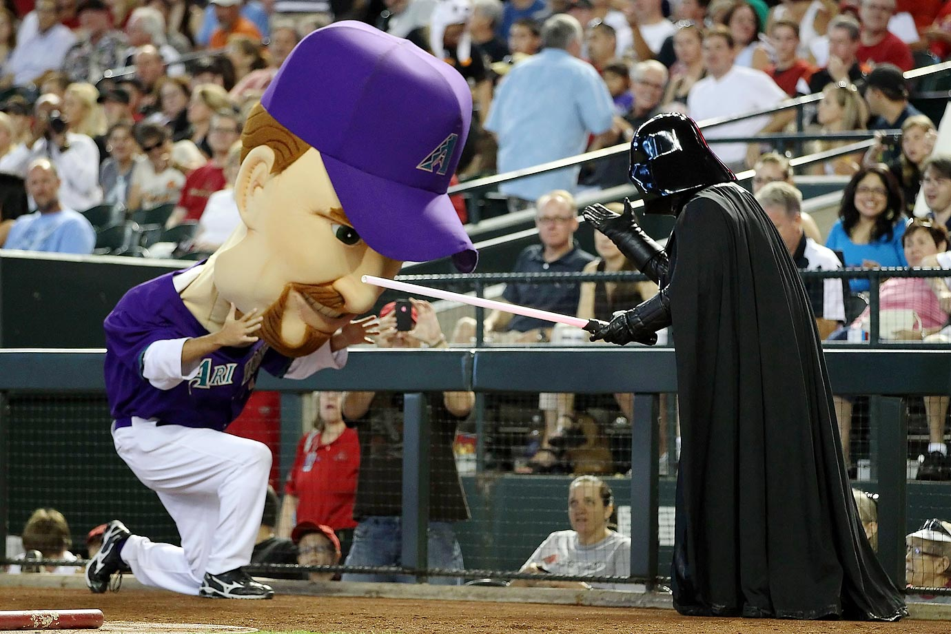 """Arizona  Diamondbacks """"Legend"""" Mark Grace is stopped by Darth Vader on """"Star Wars Night"""" during the D-Backs game against the San Francisco Giants on Sept. 25, 2011 at Chase Field in Phoenix."""