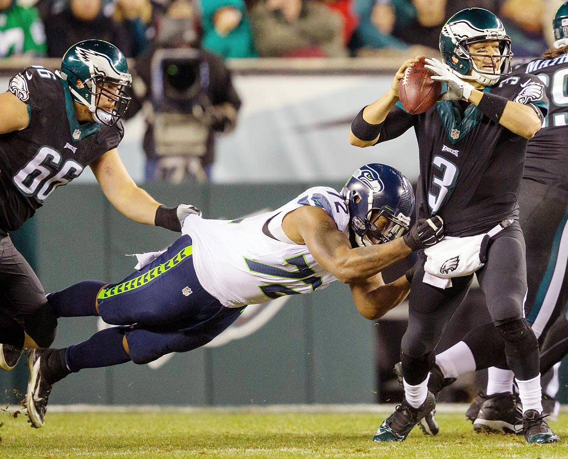 Mark Sanchez is sacked by Michael Bennett of Seattle.