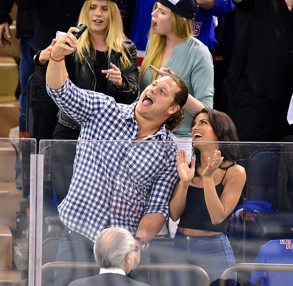 Markus Kuhn of the New York Giants takes a selfie with a friend at the Washington Capitals vs New York Rangers playoff game.