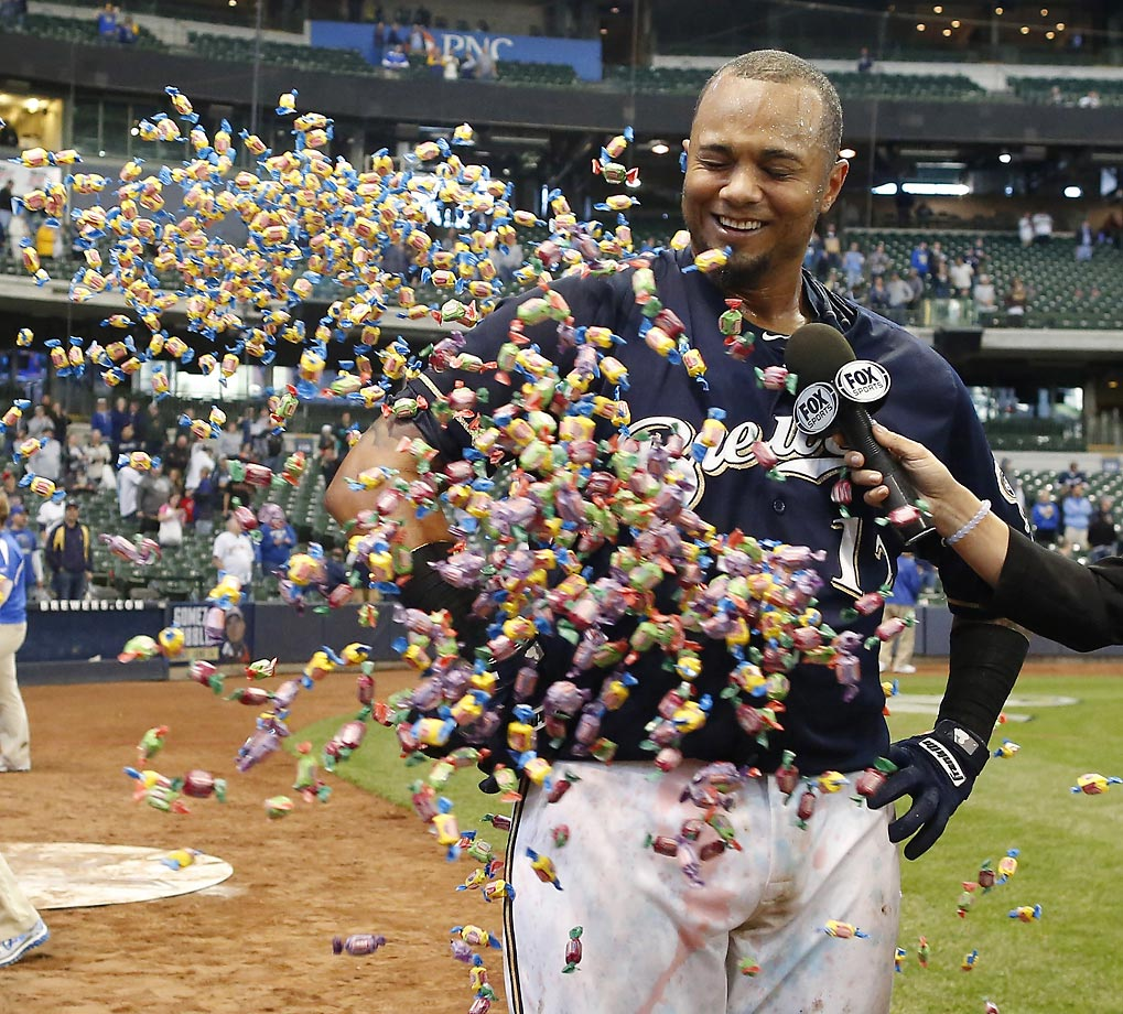 Martin Maldonado of the Milwaukee Brewers is showered with bubble gum during a postgame interview after a victory over the  Diamondbacks in the 17th inning.  Maldonado hit the game-winning homer.