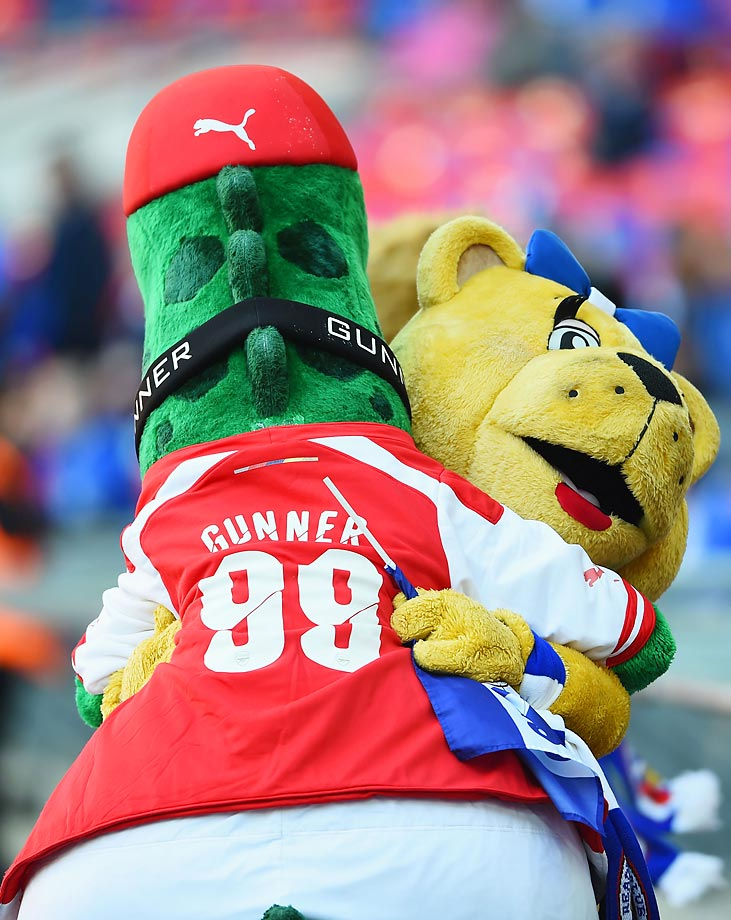 Gunnersaurus, the Arsenal mascot, makes friends with the Reading mascot during the FA Cup semifinal.