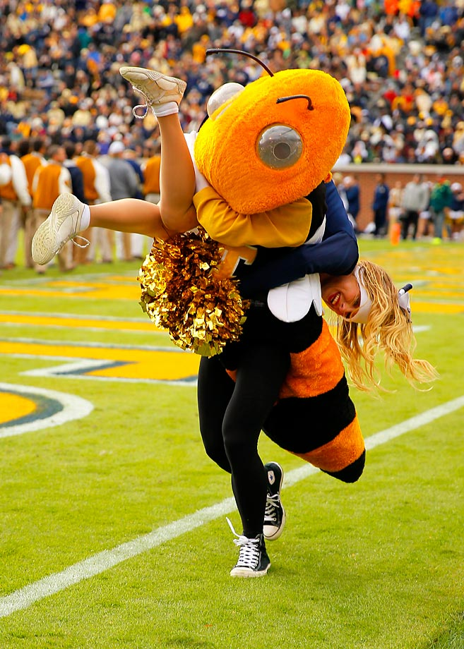 Buzz, the Georgia Tech mascot,  carries away a cheerleader during the Yellow Jackets' win over Virginia.