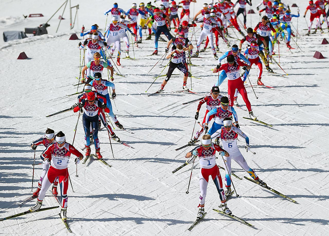 View of the start of 30 km Mass Start Free.  Marit Bjoergen (left) of Norway won gold, and Therese Juhaug (right) also of Norway won silver.