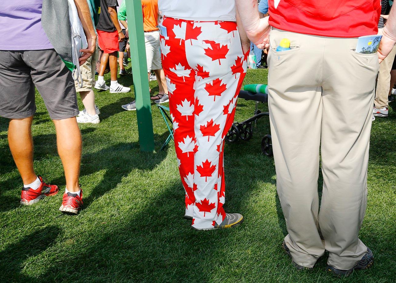 A fan wearing maple leaf pants enjoying the Masters.