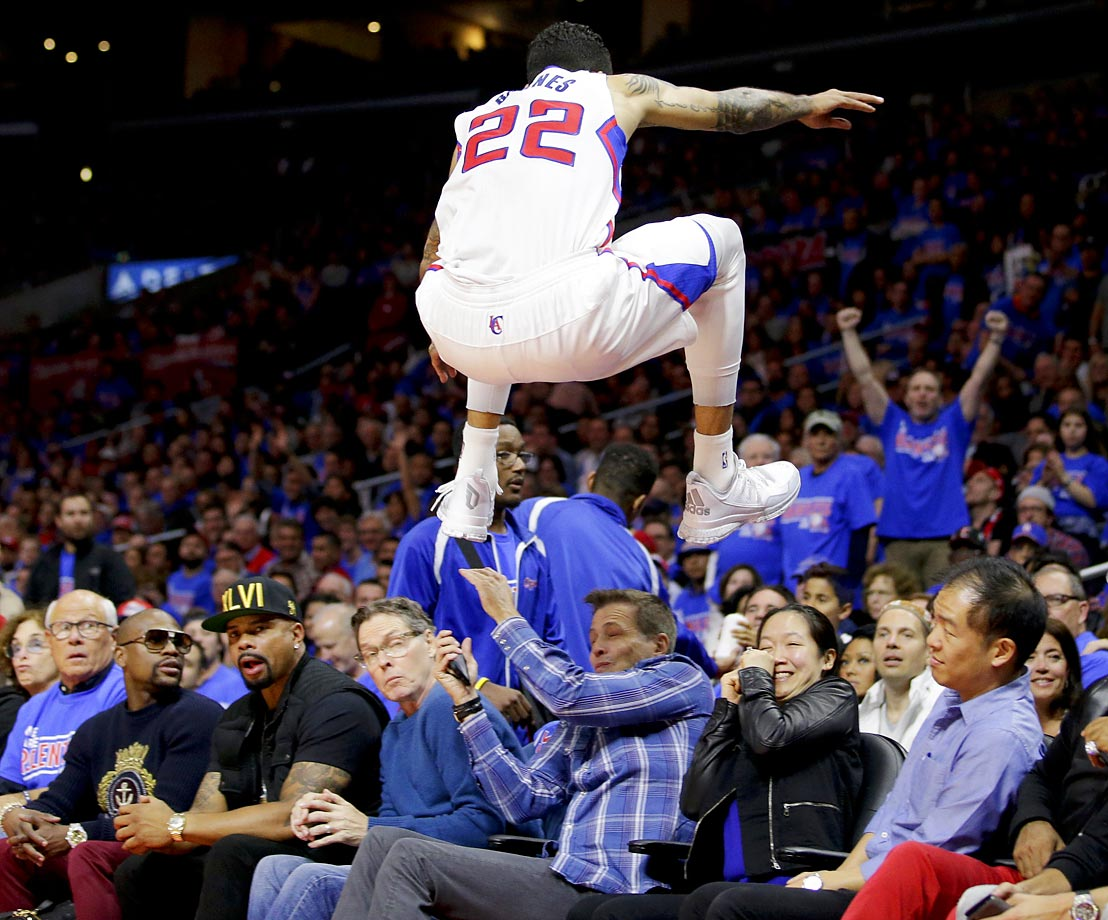 Matt Barnes of the Clippers soars into the stands during a playoff game against the Rockets.