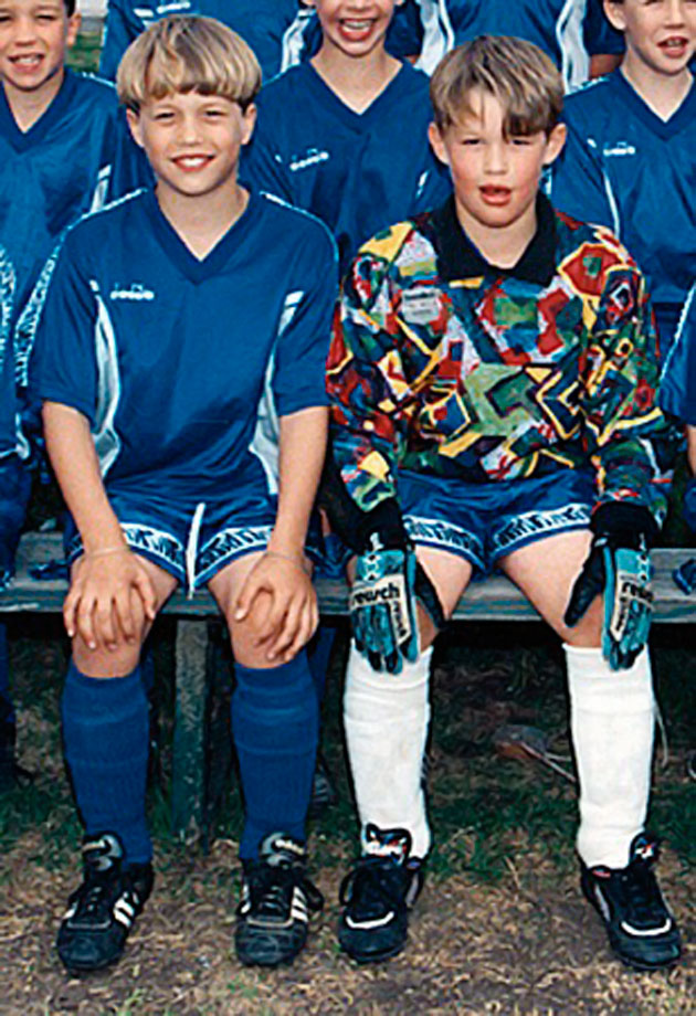 Matthew Stafford (left) and Clayton Kershaw pose for their youth soccer team photo.
