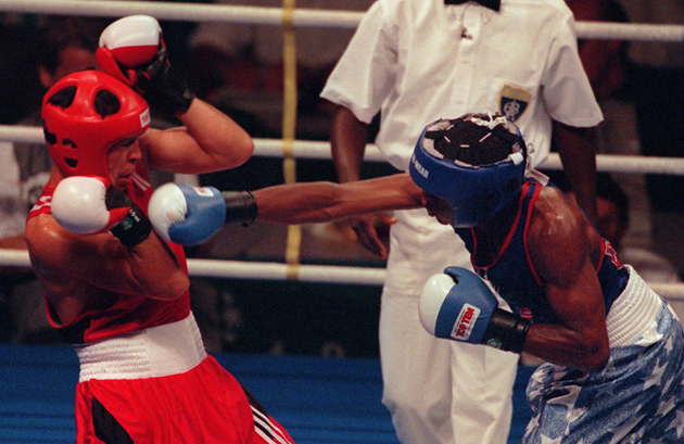 Mayweather hammers Bakhtiyar Tileganov 1996 in Atlanta. Mayweather went on to win the preliminary bout.