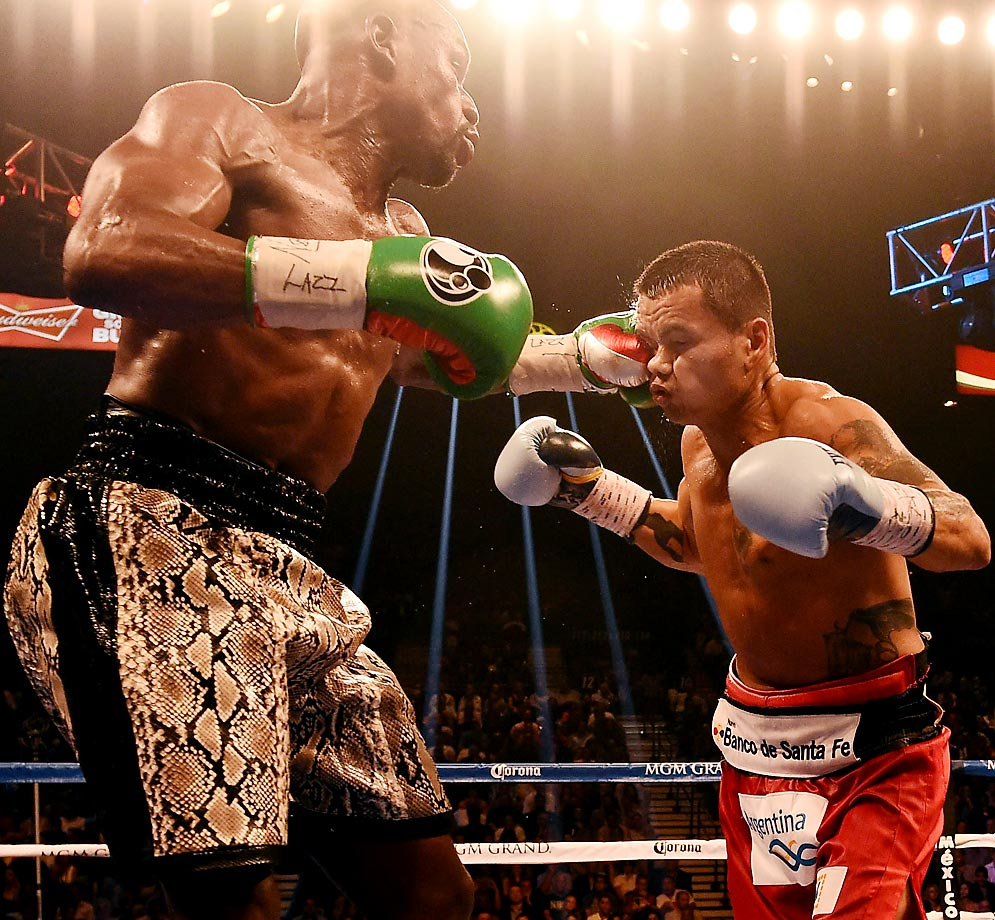 The champ kept his welterweight and junior middleweight belts with a unanimous decision in his rematch with Maidana. The judges scored 116-111, 116-111 and 115-112.