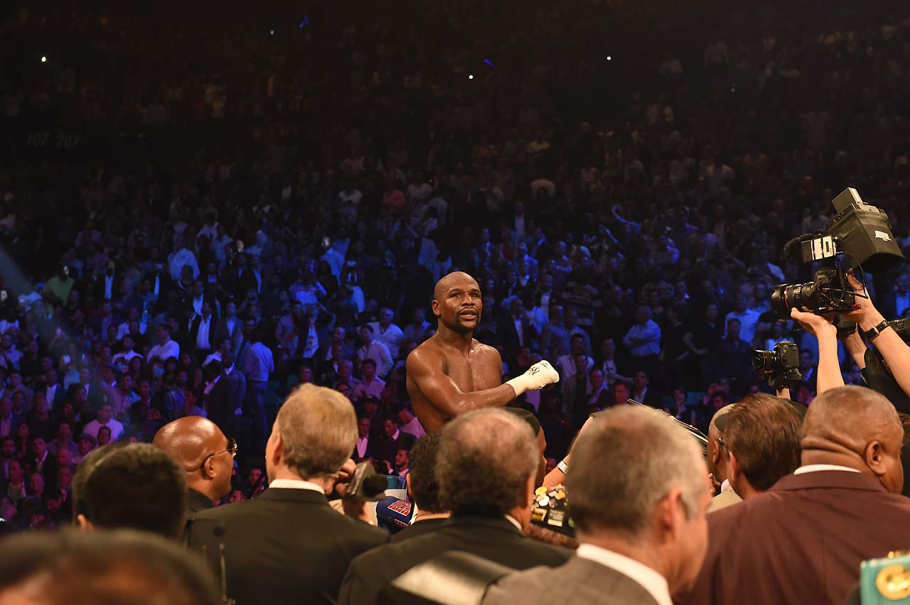 In the final seconds of the fight Mayweather raised his right hand in victory and after the bell rang stood on the ropes, pounding his heart with his gloves. (AP)