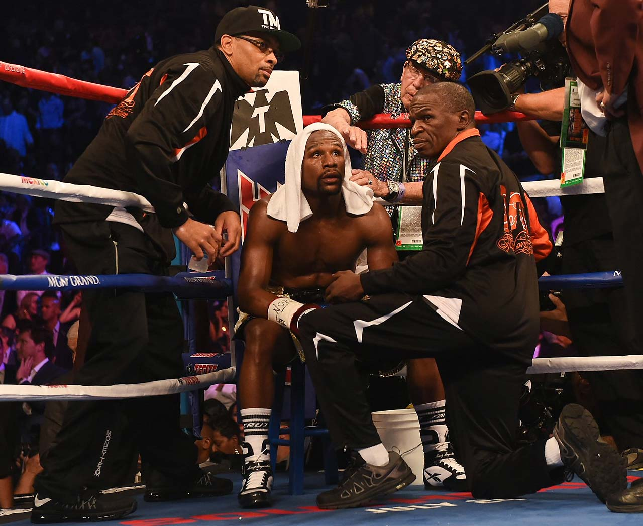 In the corner, Mayweather's father kept yelling at his son to do more. But Mayweather was content to stick with what was working and not take a risk that could cost him the fight. (AP)