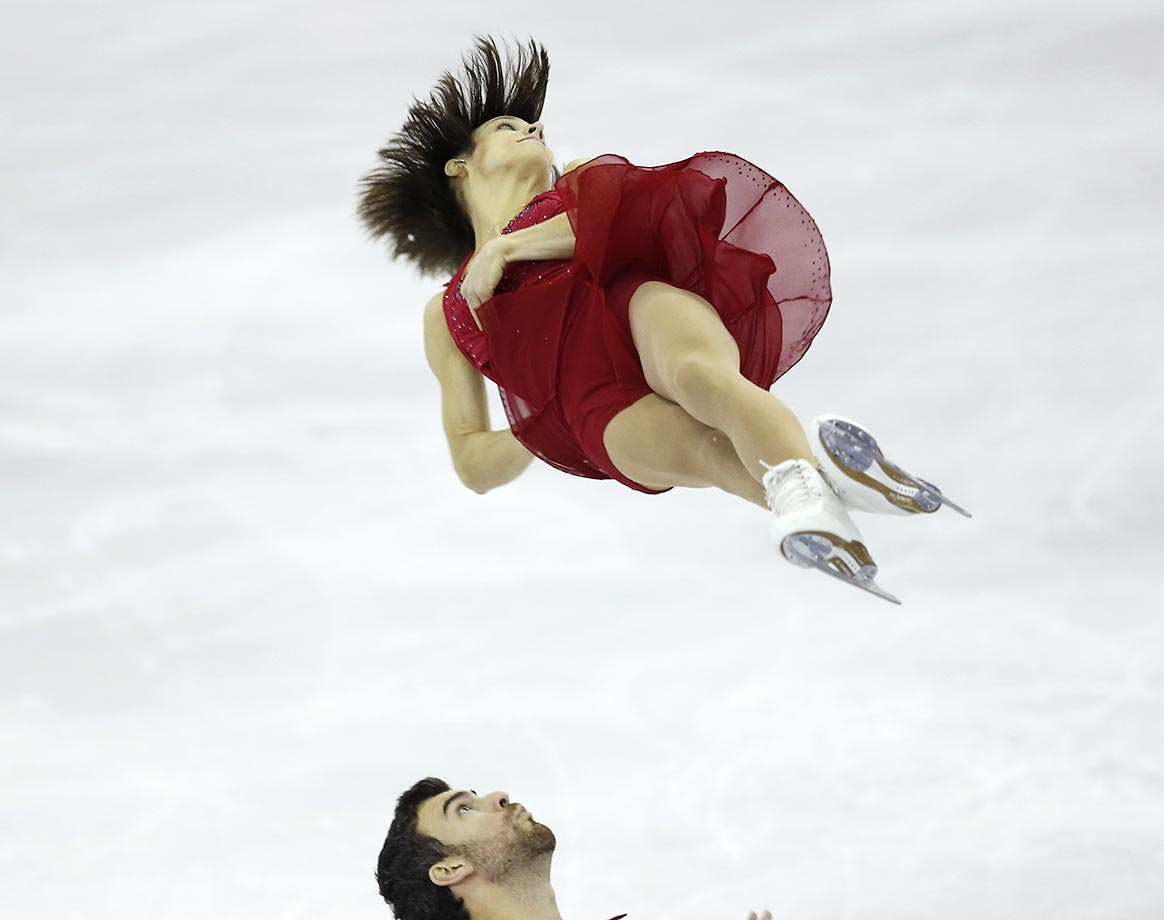 Meagan Duhamel and Eric Radford of Canada perform during the Pairs Short Program Final of the Grand Prix Final figure skating competition in Barcelona.