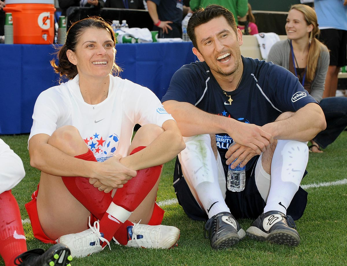 Retired soccer player Mia Hamm and former ballplayer Nomar Garciaparra have been married since 2003 with twin girls, Grace and Ava, and a son, Garrett.