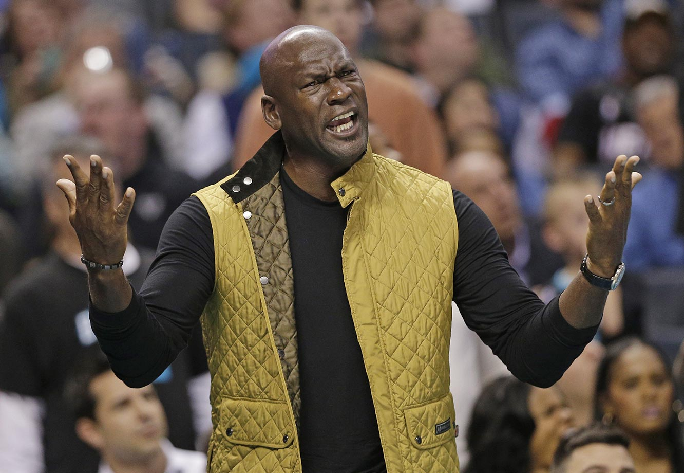 Charlotte Hornets owner Michael Jordan reacts to a call during his squad's game against the Miami Heat.