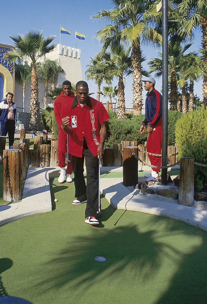Michael Jordan is fired up after converting a putt. (Manny Millan/SI)