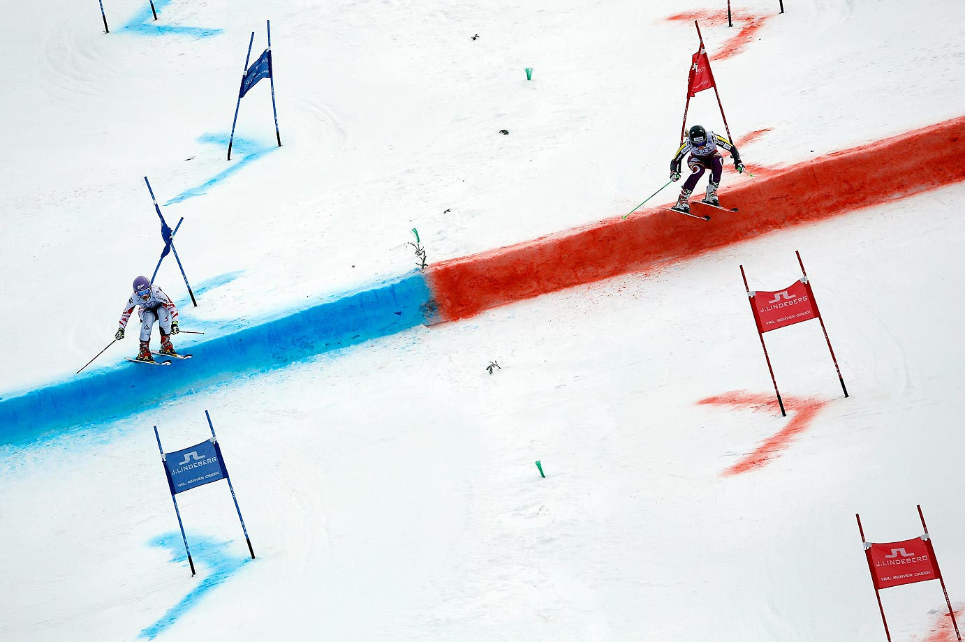 Michaela Kirchgasser of Austria (left) races Ragnhild Mowinckel of Norway during the Nations Team Event at Golden Peak Stadium on Day 9 of the 2015 FIS Alpine World Ski Championships.