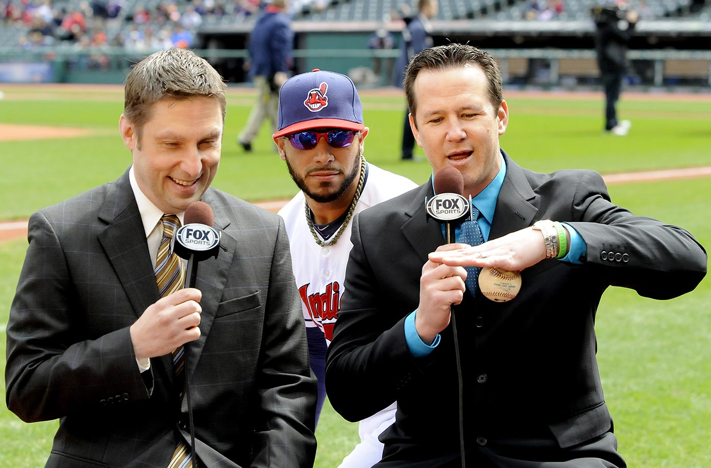 Mike Aviles of the Cleveland Indians sneaks up behind pregame hosts Al Pawlowski and Jason Stanford.