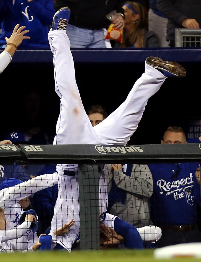 Mike Moustakas of the Kansas City Royals catches a foul ball during Game 3 of the American League Championship.