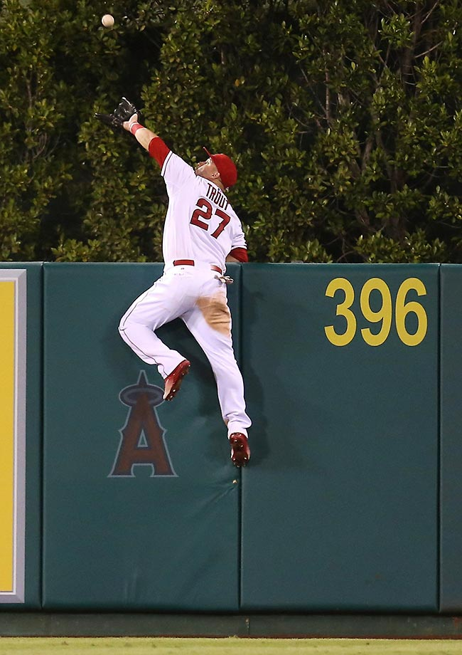 Mike Trout of the Angels robs Jesus Montero of a home run during a game between the Angels and Mariners.