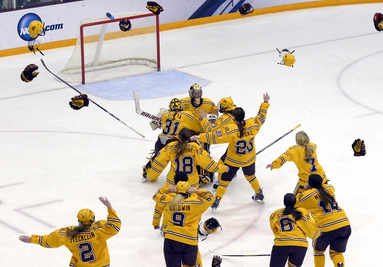 Minnesota players celebrate winning the NCAA Frozen Four championship against Harvard in Minneapolis. Minnesota won 4-1.