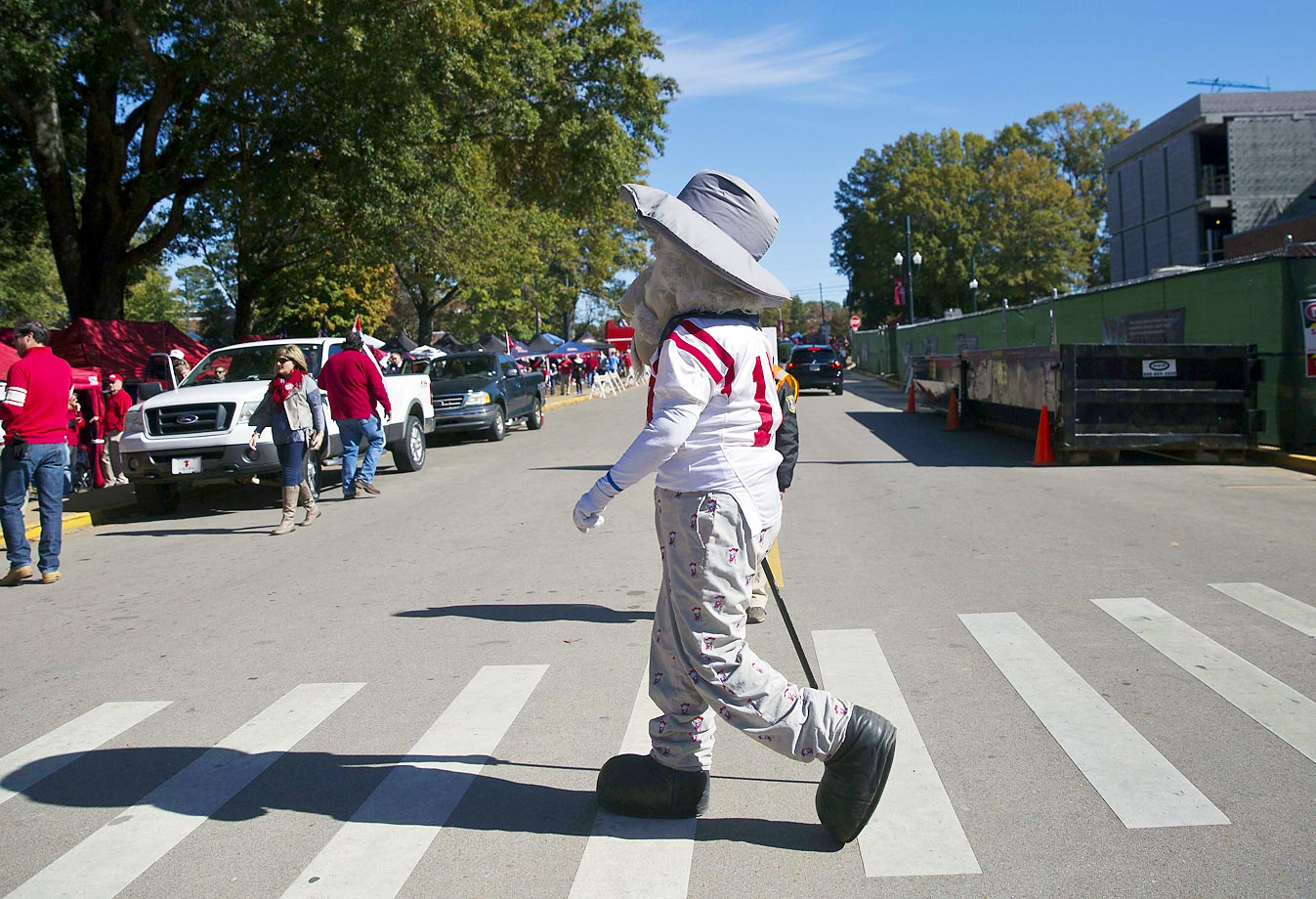 The former Mississippi mascot, Colonel Reb, walks across the road towards the Grove for tailgating before the game against Auburn.