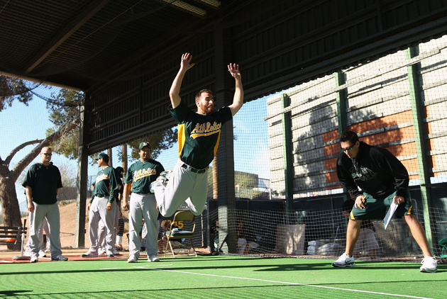Pitcher Vinnie Chulk participates in a jumping drill during a recent MLB spring training practice at Phoenix Municipal Stadium in Phoenix, Arizona.