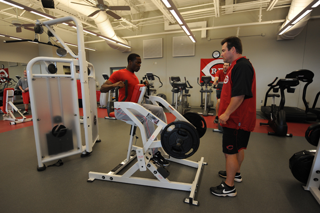 Aroldis Chapman of the Cincinnati Reds works out in the weight room prior to a game against the Cleveland Indians at Goodyear Ballpark in Goodyear, Arizona.