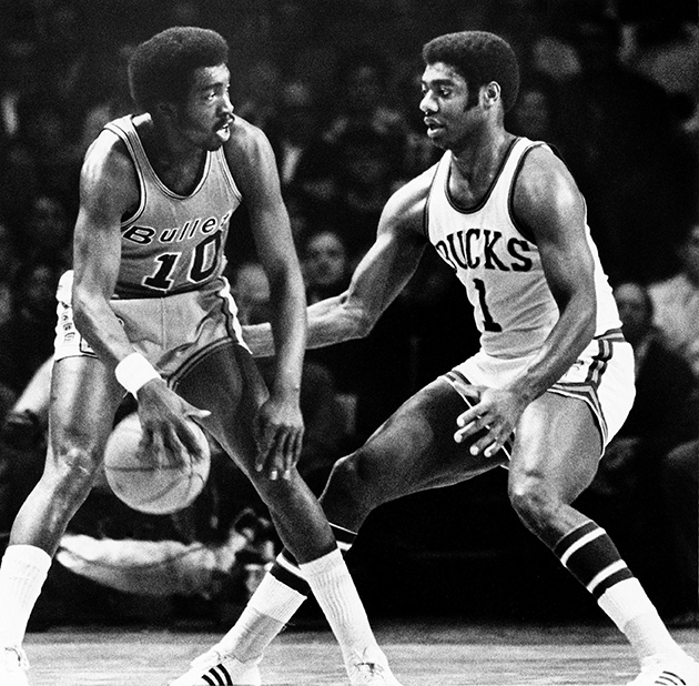 Earl Monroe of the Baltimore Bullets moves the ball against Oscar Robertson during a game against the hometown Milwaukee Bucks at the MECCA Arena in 1970.