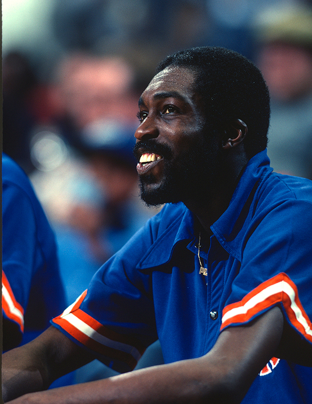 Earl Monroe of the New York Knicks looks on from the bench against the Washington Bullets during an game in 1977 at the Capital Centre in Landover, Maryland. Monroe played for the Knickers from 1971-80.
