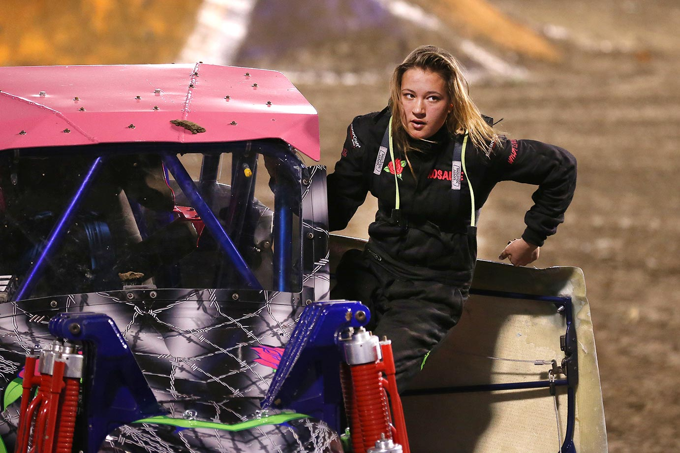 Monster Truck's youngest female driver, 18-year-old Rosalee Ramer, climbs out of her 'Wild Flower' Monster Truck during a break in the competition.