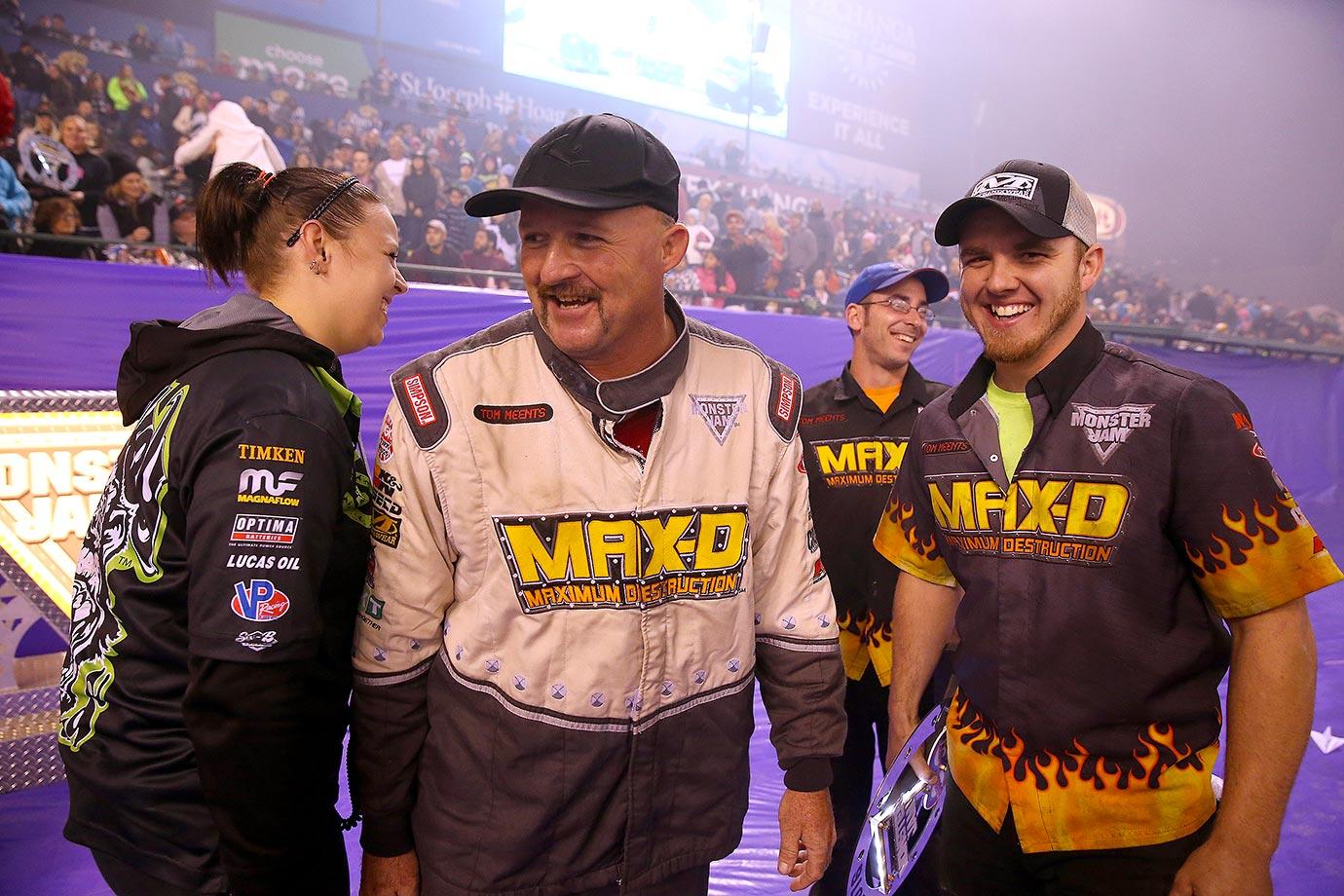 Monster Truck's 'Max-D' driver Neil Elliott (center) is all smiles on the podium after winning the Monster Jam.
